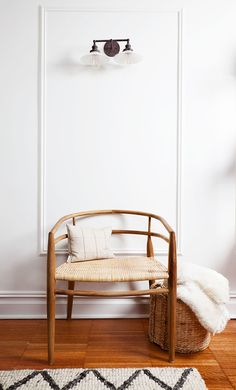 create a mini moment with a small sconce, some trim and the perfect chair | coco+kelley