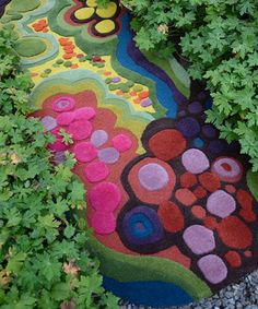 A flower carpet garden near Paris. Delphine, a French gardener, is passionate about all gardens. She lives 35 km north from Paris. She gardens with her husband, Lucien, who is a garden designer..