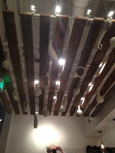 Hang white squash from wooded boards on the ceiling.