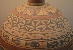 Pottery found from the Archaeological museum of Nicosia, Cyprus. In addition to this, other vessel and terracotta torso on same museum had Flower of Life decoration belt. Flower motifs on vessel and fish pictures or vesica piscis may very well have been consciously selected by painter. Object dates to 750-600BC ie. Cypro-Archaic 1 Period. (Photo by Marko Manninen) All Religious Symbols, Iron Age, Flower Of Life, Ancient Art, Sacred Geometry, Archaeology, Swirls, Jewelry Art, Decorative Accents