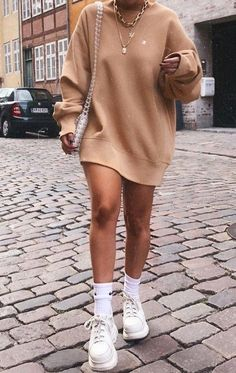 Oversized jumper dresses, ankle socks and chunky trainers are also a staple in Beers wardrobe. Definetly key for her streetwear looks.