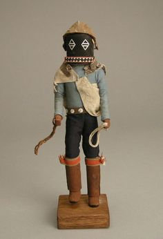 A Zuni hand carved kachina doll representing the Hopi kachina Lotsin or Whipper kachina