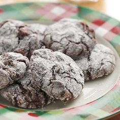 Super Easy Brownie Crackles made with brownie mix. 1 package fudge brownie mix (13-in. x 9-inch pan size), 1 cup all-purpose flour, 1 egg, 1/2 cup water,  1/4 cup canola oil, 1 cup (6 ounces) semisweet chocolate chips, Confectioners' sugar