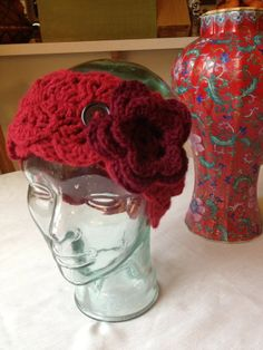 Super cute headband, Deep red Caron One Pound acrylic yarn with a Cabernet colored flower. This has a couple buttons so you can adjust it to fit your head, or even as a neck warmer if you wanted. $15 includes shipping from cat friendly, smoke free home.