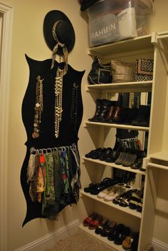 Closet Organization~ I used mirror tiles between the shelves and painted background to add visual interest, making accessories stand out. Jewelry and scarf organization