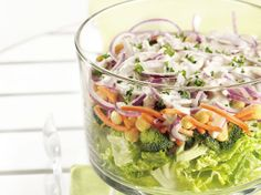 Show off crunchy-fresh veggies, nutritious beans, and bright greens in this pleasing salad with easy Parmesan cheese dressing.