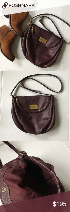 """Marc by Marc Jacobs Burgundy crossbody bag In great used condition, clean inside and outside, gold hardware, no wear or tear on strap.Details This generous, stylish bag features a flap that unzips for double the room, as well as lightly textured Italian leather. - Adjustable shoulder strap - Top zip flap with magnetic closure - Exterior features solid leather construction with logo plate - Interior features wall zip pocket and wall slip pockets - Approx. 11.5"""" W x 8"""" H x 5"""" D - Approx…"""
