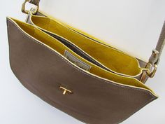 ethical leather bag, amazing contrasting yellow suede lining