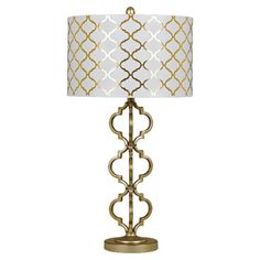 Cast a warm glow in your den or master suite with this eye-catching table lamp, showcasing an elegant trellis-inspired design, matching drum shade, and a shi...