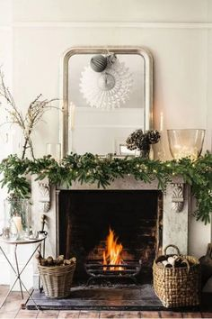 Have a look at the comfort level photos of Christmas Decoration Ideas Bringing The Christmas Spirit from a real expert - British company The White Company. Fireplace Mantel Christmas Decorations, Christmas Mantels, Noel Christmas, Rustic Christmas, Xmas Decorations, White Christmas, Christmas Greenery, Hygge Christmas, Fireplace Ideas