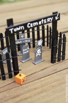 Make these miniature popsicle stick tombstones and cemetery for a fun Halloween tablescape. Also a fun fairy village addition or dollhouse miniature! garden ideas popsicle sticks Popsicle Stick Tombstones and Cemetery - Ashley Hackshaw / Lil Blue Boo Halloween Wood Crafts, Halloween Tombstones, Halloween Fairy, Halloween Projects, Diy Halloween Decorations, Diy Halloween Village, Vintage Halloween, Fall Crafts, Happy Halloween