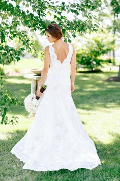 lace wedding dress back // photo by Kina Wicks // http://ruffledblog.com/romantic-illinois-farm-wedding