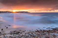 The 22-year-old lifeguard has taken many stunning shots like this of the skyline from the ...