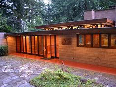 """Home Exterior: Brandes House by Frank Lloyd Wright . . . Frank Lloyd Wright's Brandes House was built in Wright's """"Usonian"""" style. It's set on 3.2 acres and features a hovering horizontal roofline spans over the carport, connecting the main living area to a 400-square-foot shop/office."""