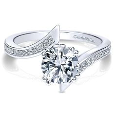 Petit bypass diamond engagement ring available at Emma Parker & Co.