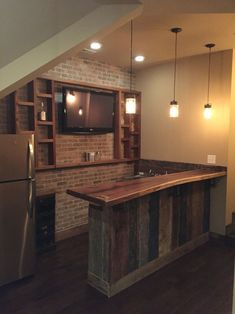 The bar is complete with incredible custom walnut top, barn wood surround, brick veneer wall and rough sawn cedar shelving. I like the shelf on wall Basement Bar Plans, Basement Bar Designs, Home Bar Designs, Basement Makeover, Basement Remodeling, Basement Ideas, Rustic Basement Bar, Small Basement Bars, Man Cave Basement