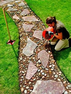 Mine won't be so manicured, but I want to make one similar to this through my garden using our native rocks. pebbled stepping stone path 6