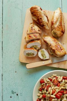 A simple stuffing of canned artichoke hearts, spinach, roasted almonds, and savory Parmesan upgrades the usual chicken breast and turns this staple into a divine dinner. Get the recipe.   - WomansDay.com