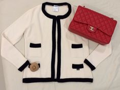 Chanel cardigan, handbag and camellia brooch. Can't go wrong with this combination.