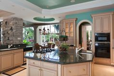 Custom-made kitchen cabinets and island designs are excellent for creating unique and comfortable kitchen interiors