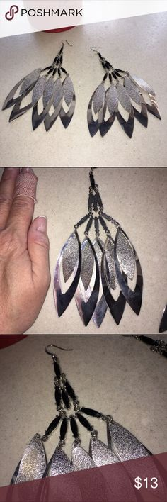 """Fun giant earrings Cute silver earrings! Pierced wires with black beading detail at top - and a pattern of 5 hanging leaf shaped silver shapes with smaller sparkly silver leaves on top of each! I've never worn these but no tags. Not TOOOO heavy but a little bit of pull as they hang.   6"""" long and 3-1/2"""" across at widest point (but more like 2/1/2"""" as they hang on your ear). Jewelry Earrings"""
