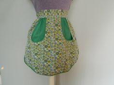 Check out this item in my Etsy shop https://www.etsy.com/listing/292576239/green-floral-vintage-apron-tie-back-two
