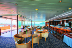 Amazing Tahiti views! La Palette - This versatile lounge offers morning snacks, serves as the backdrop for special events, hosts Polynesian activities led by Les Gauguines, and is the perfect place to grab a nightcap and dance under the stars to live music. #pgcruises