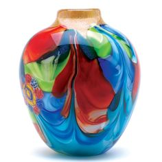 This individually hand crafted jug-shaped vase is a treasure of glowing color and graceful garden imagery. Actual item may vary in colors from the picture shown here. Floral Fantasia Art Glass Vase by Rustica House. #myRustica