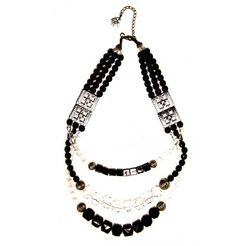 A sensational three strands of black pearl, silver medallions, silver filigree beads and clear and black crystal. $25