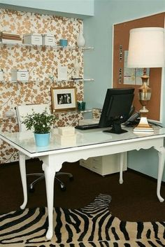Use a small kitchen table with a piece of glass over the top for a desk