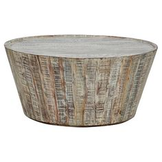 Crafted from reclaimed wood planks, this artful coffee table pairs well with a cozy sheepskin rug or vibrant accent chair.  Product:...