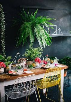 Summer Table Decorating Ideas black dining room with yellow chair and palms