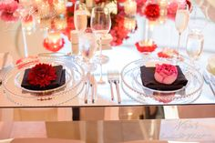 Nisie's Enchanted Florist -- A single floral bud accents beautifully as napkin treatments, red roses on black napkins, red and pink florals, weddings, nisies enchanted #napkingtreatments