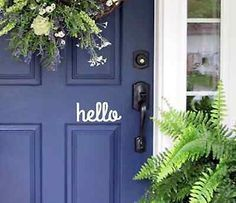 LOVE the color of this front door for our house. Hello Front Door Decal