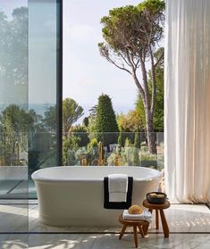 "Polubienia: 1,135, komentarze: 30 – Amanda Kelly Interiors (@amandakellyinteriors) na Instagramie: ""Bathroom with a view. Designed by @humbertetpoyet 📷: @francisamiand"" Bathroom Inspiration, House Design, Freestanding Tub Filler, Architectural Digest, Free Standing Tub, Home, Flooring Inspiration, Modern Country, Dream Spaces"