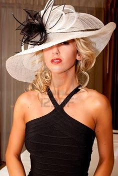 Fashionable woman in elegant hat and dress