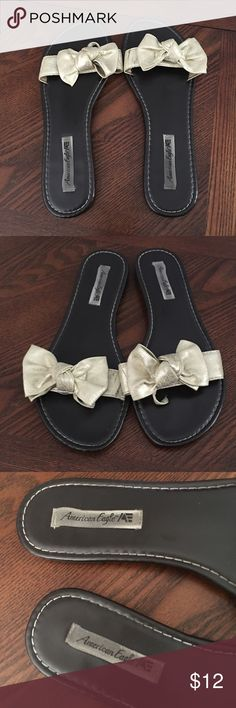 American Eagle sandals American Eagle sandals/flops with a gold bow detail. Super cute, gets lots of compliments American Eagle by Payless Shoes Sandals