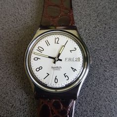 1990 Vintage Swatch Watch, Elegant ready to be worn    1990 Vintage Swatch Watch.  Water resistant 30 meter / 100 Feet.  Diameter case 33 mm. Leather band.  New, never worn