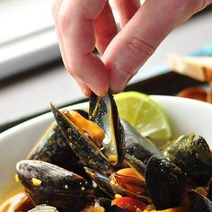 Thai Red Curry Mussels — Sweet-and-spicy curry with the sweet-and-briny mussels make an irresistible pairing. Starts with a garlicky coconut milk-based broth and enhanced with grated fresh ginger and a cup of chicken broth in order to create more sauce that should be sopped up with chunks of crusty bread.