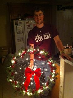 wreath made out of a bike rim! so clever :) anyone who wants one..let me know!