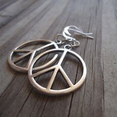 These earrings created by Jewelry By Luet and Co are made of: silver plated : peace sign charms, earring hooks and findings. These earrings measure 2 inches in length. We offer free shipping (via USPS…MoreMore  #SilverNiceJewelry