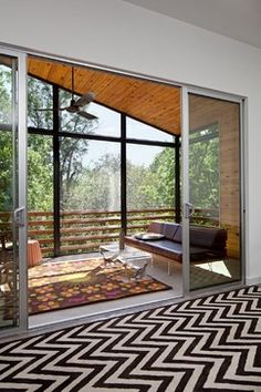 Great porch idea, glassed in for the winter, accordion doors or large sliders for the summer. Milton Duplex - 5 star energy rated - contemporary - porch - austin - Forsite Studio