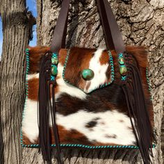 A Buckaroo Diaper Tote with turquoise stones and turquoise leather stitching. This one went to Mississippi.  gowestdesigns.us