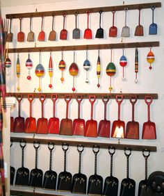 Sandra Mackintosh East Market Street Antiques - collection of small children's pail shovels and bobbers