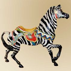 "Dentzel - $27,500  Dentzel Zebra, 1910-1920, probably outside row.  Rare figure with wonderfully expressive face and bold double bird saddle cantle. Provenance: The Wallace Kraspf Collection, Macedon, NY. Older restoration, minor cracking. 62"" long x 58"" high."