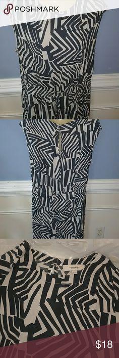 Ann Taylor Loft rayon dress Gray and biege rayon print dress. Skirt is fully lined. Elastic style waist. Short sleeved. Hand wash. Length is 38 inch shoulder to hem. Never worn dress. Loft Fashion Dresses Midi
