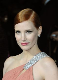Jessica Chastain - bubble-gum pink lip shade, wing-tipped eyes and a simple bun at the 'Interstellar' London Premiere (October 2014)