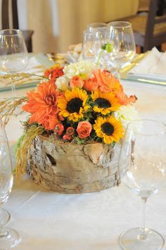 Sunflowers wedding centerpiece- Buy bulk sunflowers by the stem or the box at BunchesDirect http://www.bunchesdirect.com/index.php/sunflowers.html