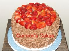 Strawberry cake with strawberry filling with a whipped chocolate icing with fresh strawberries for the top