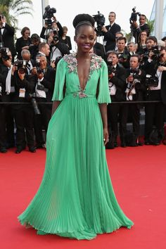 For the opening ceremony of the 68th Annual Cannes Film Festival, Lupita Nyong'o wore a Gucci one-of-a-kind jade colored embroidered chiffon gown.
